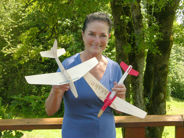 Jim Walker's daughter, Valerie, holding the rocket gliders