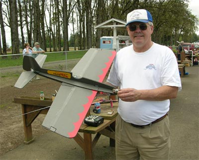 Merl Hoem holds his Foamy Firecat, a radio controlled plane of his own design