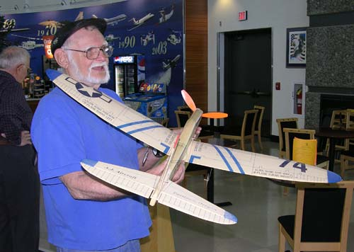 Gil Coughlin holds the radio controlled 74 Fighter built by Tex Newman