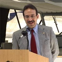 Laureano Meir speaks at the Jim Walker 101st Birthday event at the Evergreen Aviation Museum