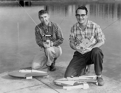 Willie Willingham and Chuck Hein with Miss Thriftway and Miss Thriftway Too, boats by American Junior. Photo was taken around 1957 at the Westmoreland Casting Pond in Portland, Oregon