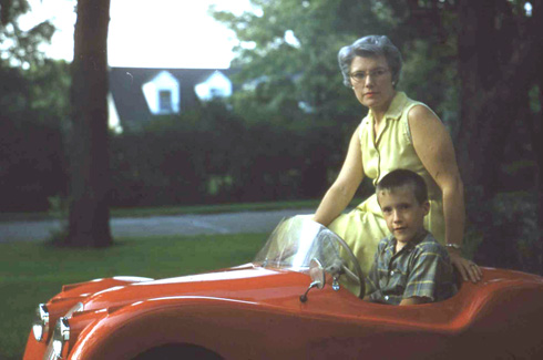 Hal Chaffee's younger brother and mother with the Jaguar XKE 120 in 1957