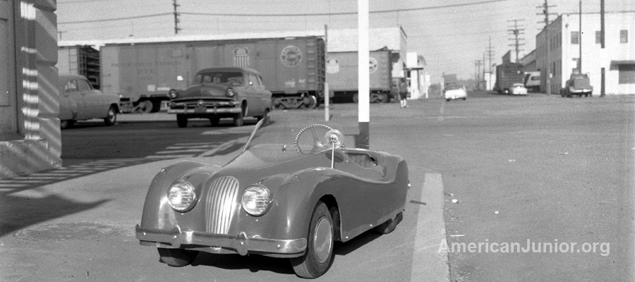 Jaguar XKE 120 outside the American Junior Aircraft Company in Portland, Oregon around 1955