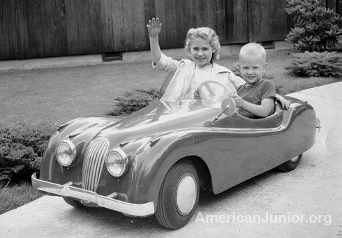 Kids riding in the Jaguar XKE 120 around 1959 in Portland Oregon